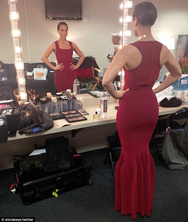 She's ready! Alicia Keys tweeted a shot of her sporting her glamorous floor length red gown ahead of singing the Nation Anthem at the Super Bowl on Sunday