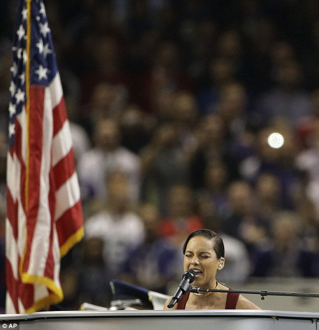 Flying the flag: The star showed no nerves as she sat down behind her silver piano