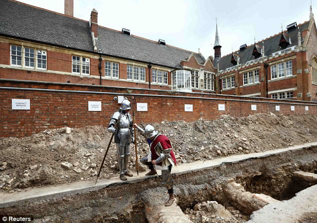 We've been looking for you: Actors dressed as knights look where archaeologists found skeletal remains during an archaelogical dig to find the remains of King Richard III in Leicester