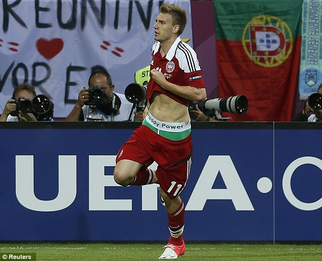 Denmark's striker Nicklas Bendtner displays the name of bookie Paddy Power on the waistband of his underpants during their Group B Euro 2012 match against Portugal