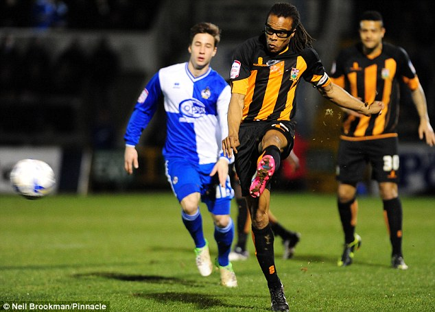 Davids dictates: Barnet player-boss Davids launches a pass during Friday's 2-1 defeat at Bristol Rovers. The Dutchman played all 90 minutes of the League Two clash
