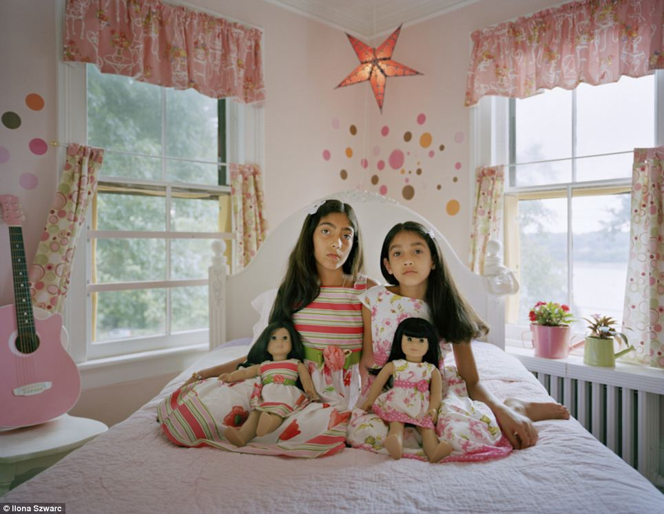 Show toys: Maya, 10, and Leela, eight, live in Northport, New York with their American mother, and Indian father; Ilona Szwarc photographed the sisters for her project 'American Girl' in 2011