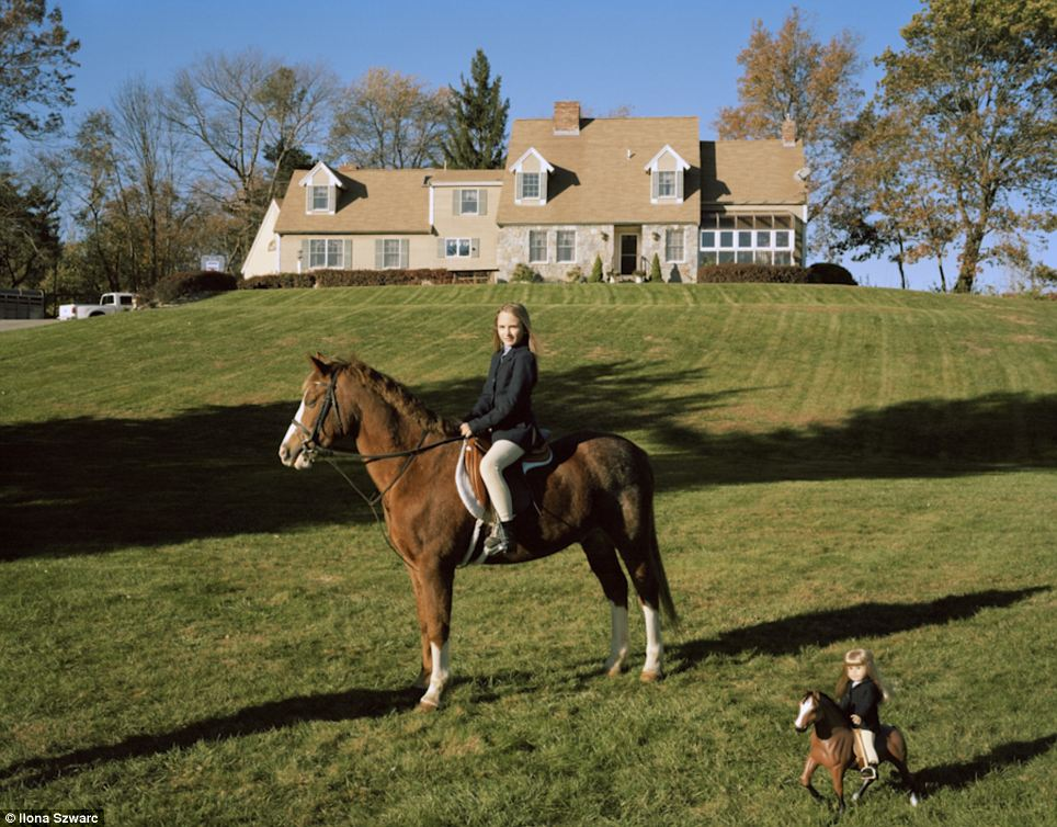 Horsing around: Jenna, 10, lives near Boston on a farm that houses 60 horses. She has 10 dolls, each with multiple horses and rising accessories