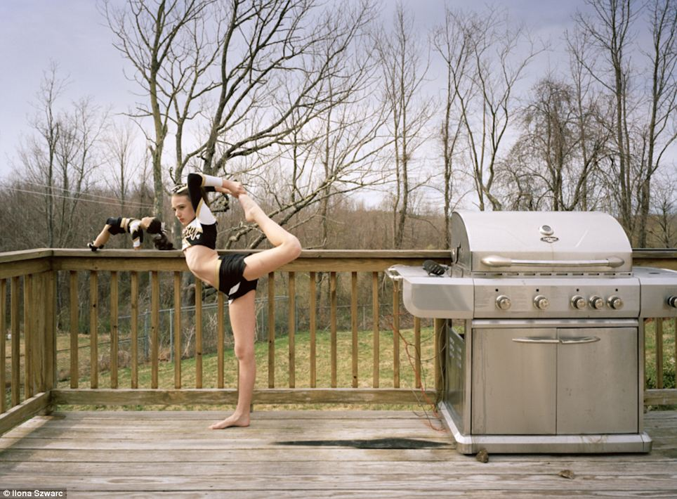 Team mate: Gymnast Hannah poses with her look alike doll on her deck in Dudley, MA