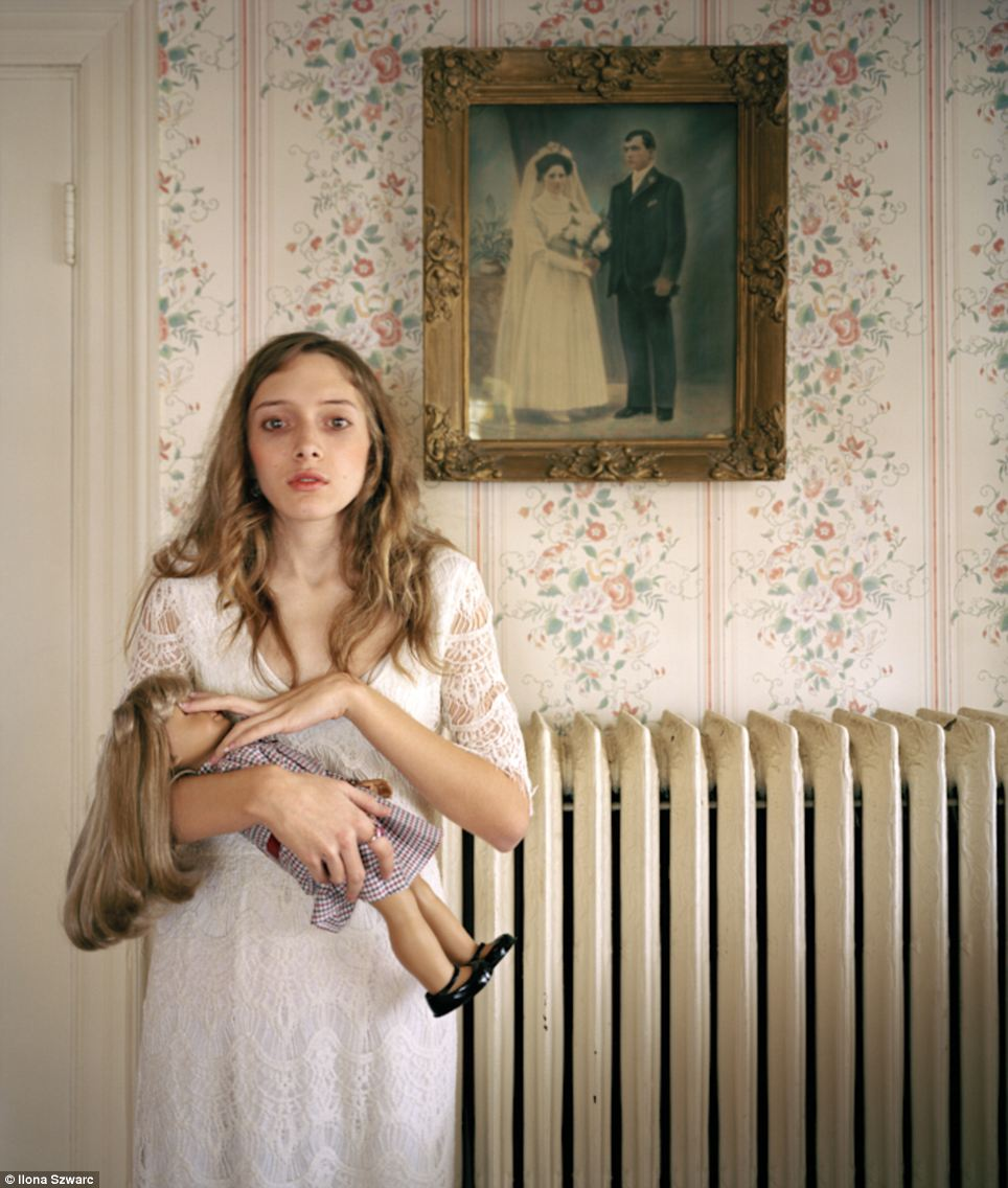 Confronting and candid: The portraits are both revealing and challenging, and Ms Szwarc hopes that her photographic project will pose important cultural questions on how feminine identiy is consrtcuted with through American Girl dolls