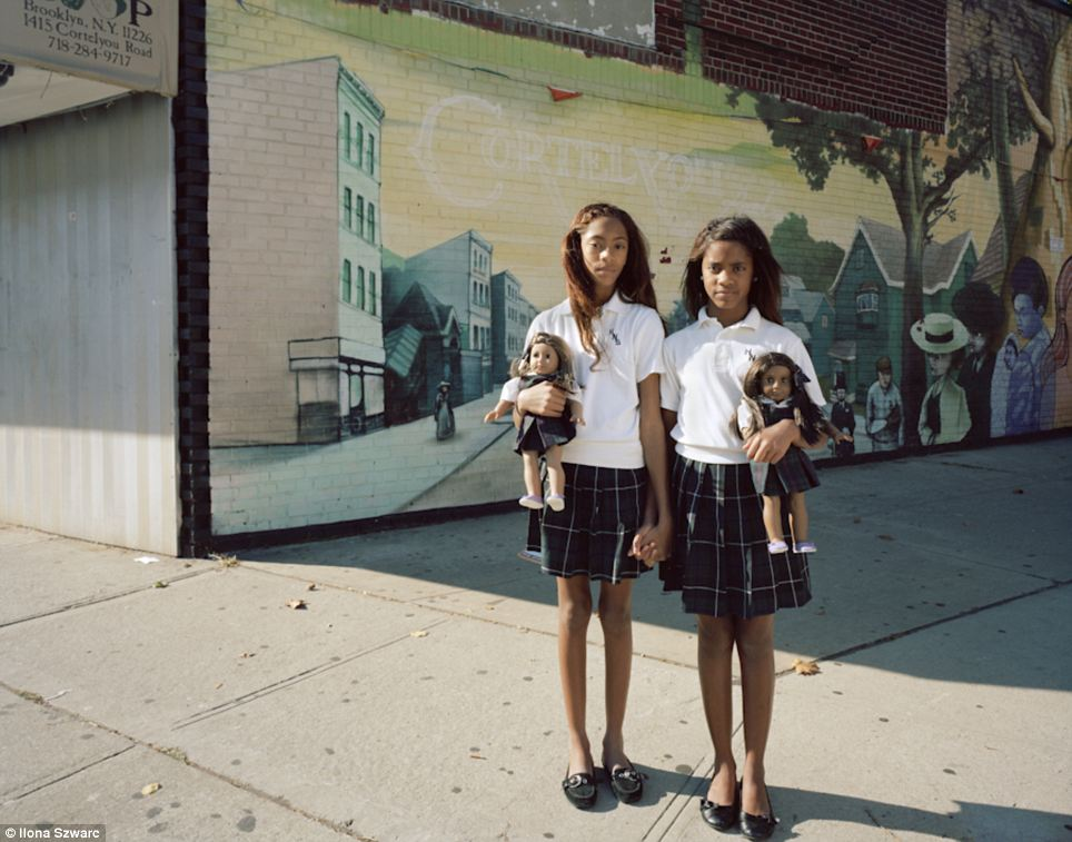 School friends: Ariane and Meridien, photographed in 2011, pose with their American Girl dolls, which each come with a background story - representing a lifestyle that becomes an intrinsic part of each girl's life