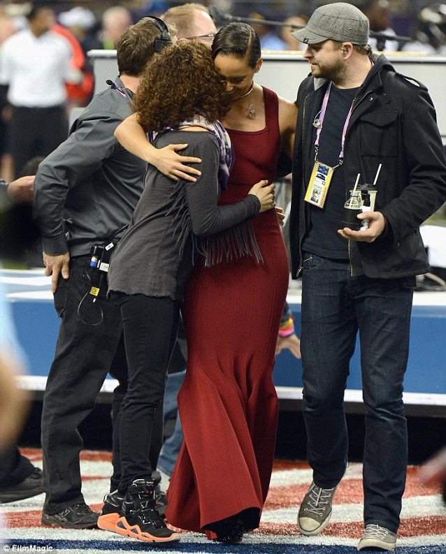 Hugging it out: Alicia embraced a friend following her acclaimed performance
