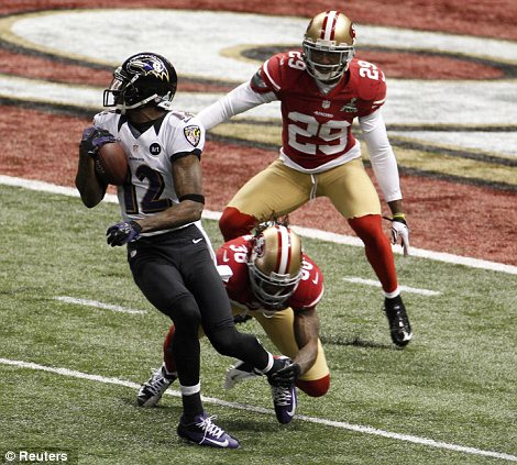 Moments before the blackout: Ravens wide receiver Jacoby Jones  runs back the opening kick-off of the second half for a 109 yard touchdown - the longest in Super Bowl history