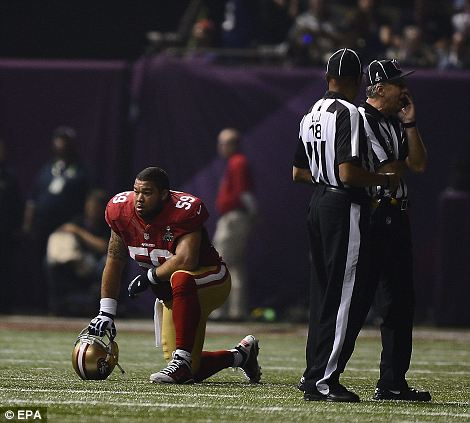 What to do? San Francisco 49ers center Jonathan Goodwin takes a knee as officials try to work out what to do