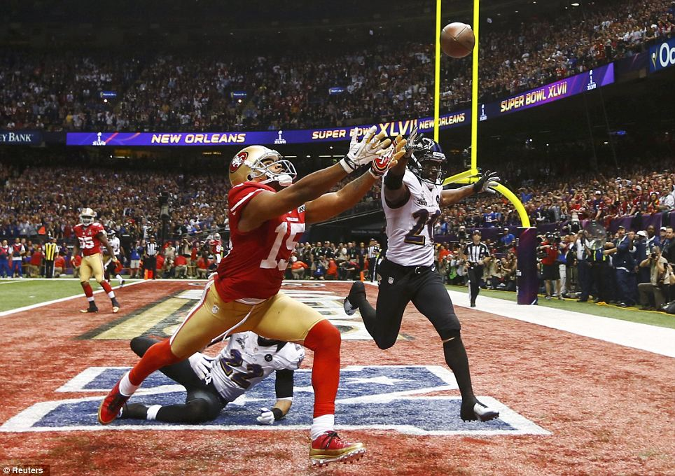 Could not catch up: San Francisco 49ers wide receiver Michael Crabtree can't reach a pass while being covered by Ravens cornerback Jimmy Smith (22) and Ed Reed