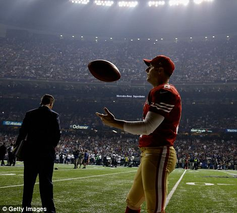 Practice time: David Akers of the San Francisco 49ers plays with a ball to keep himself entertained