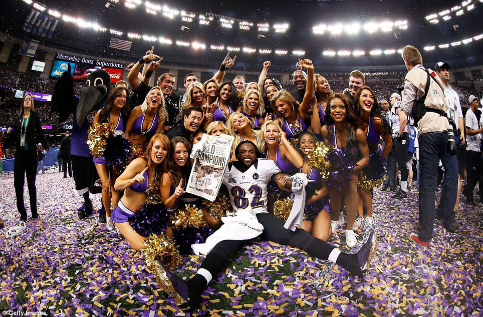 Time to celebrate: Torrey Smith of the Ravens celebrates with the Ravens cheerleaders following their win