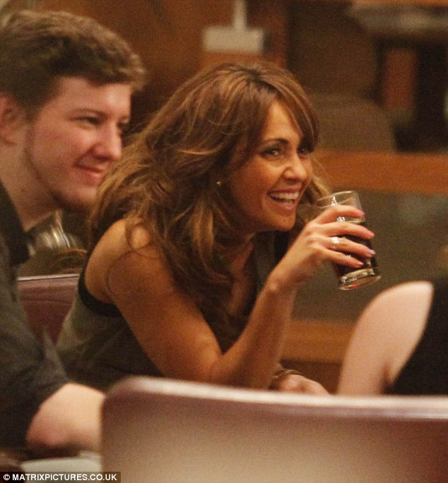 Unwinding: Samia enjoyed several drinks as she sat down following the exciting events of the night