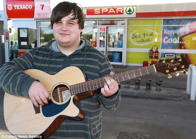 International appeal: The student, who works part-time at a petrol station in Mansfield, Manchester, now has fans in America after his YouTube video was viewed more than 600,000 times in less than a week