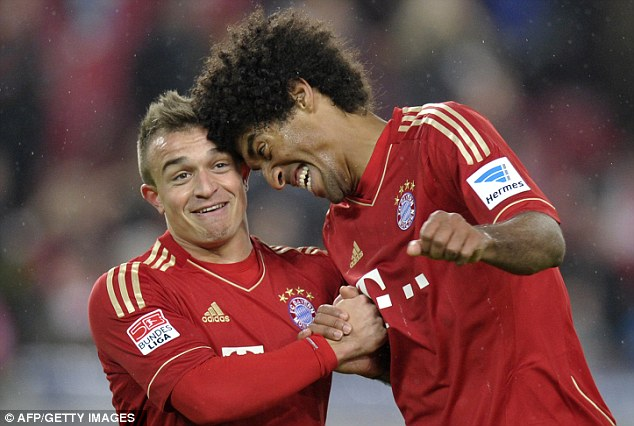 Hair-raising: Bayern Munich defender Dante (right) is instantly recognisable with his afro hairstyle