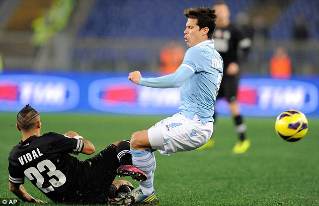 Stuck in: Hernanes goes into a tackle with Juventus player Arturo Vidal during last week's Coppa Italia tie