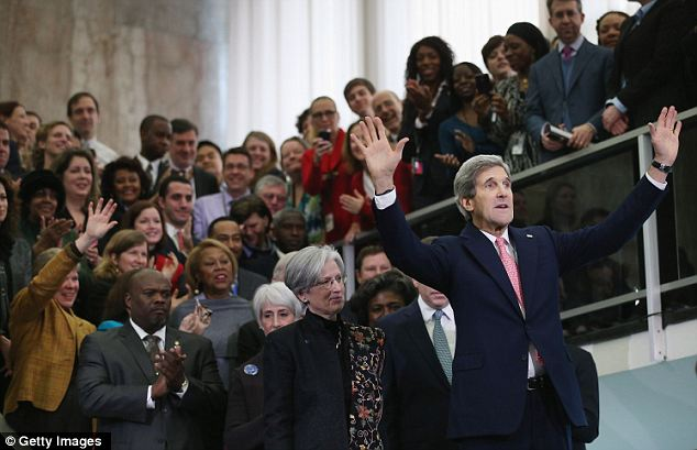 Greeting the masses: John Kerry officially started as the Secretary of State on Monday and there was a welcoming ceremony held in the lobby of the State Department in Washington
