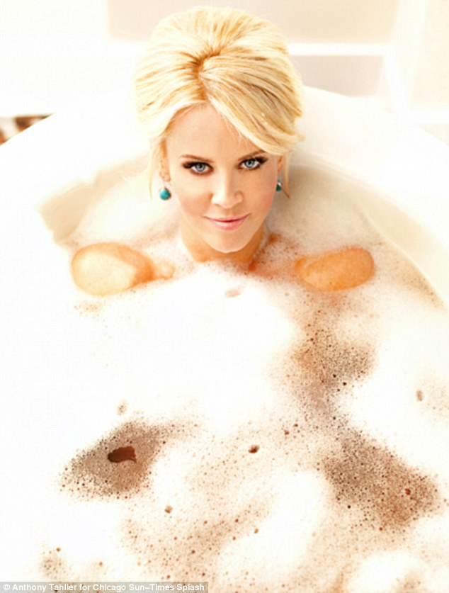 Saucy: Jenny McCarthy keeps her modesty intact beneath the suds as she poses in her bathtub for a new photoshoot