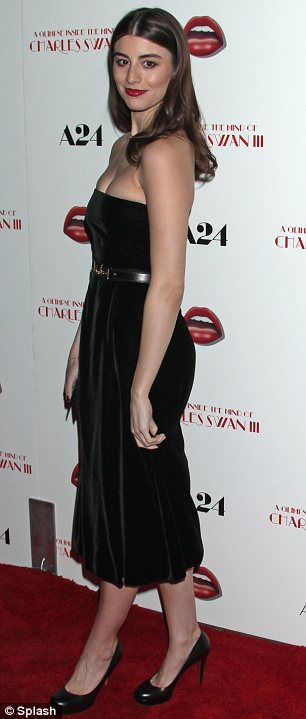 Simply style: The actress nipped in her waist with a belt added a slick of red lipstick and a matching manicure for the event