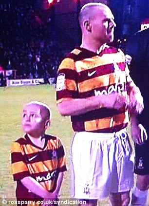 Picture shows Jake Turton cancer sufferer who led his beloved Bradford City out during there first leg against Aston Villa
