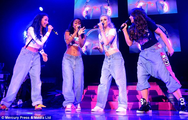 Someone missing: Perrie Edwards (second right) was absent from the girls' day out, and is believed to have been spending time with her One Direction star boyfriend, Zayn Malik