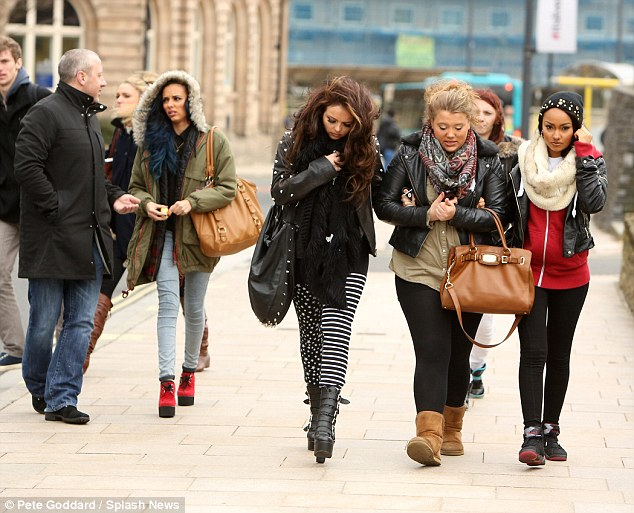A spot of sightseeing? The girls were joined by various friends and bandmate Leigh-Anne Pinnock (far right) as they made the most of a rare day off