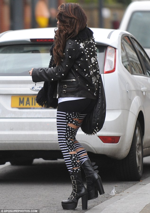 Hell for leather: Jesy teamed her punky leggings with a studded leather jacket and towering buckle-detail platform boots