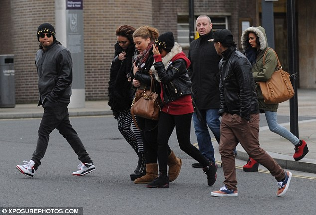 Team Little Mix: The girls were accompanied by a large entourage as they enjoyed a morning wander around Liverpool before heading off to perform in Wolverhampton on Tuesday night