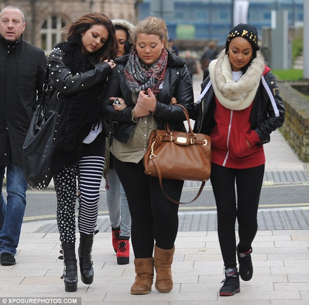 Keeping it casual: Leigh-Anne opted for an off-duty look of leggings and a red hooded jumper, which she teamed with a snuggly faux fur snood and a beanie hat