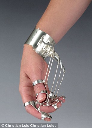 Graceful: The marionette-like jewellery also reinforces the idea of training the hand to rest in this graceful manner