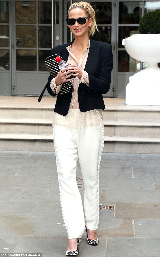 Daring: The Girls Aloud star's lace blouse left little to the imagination when it came to her choice of underwear