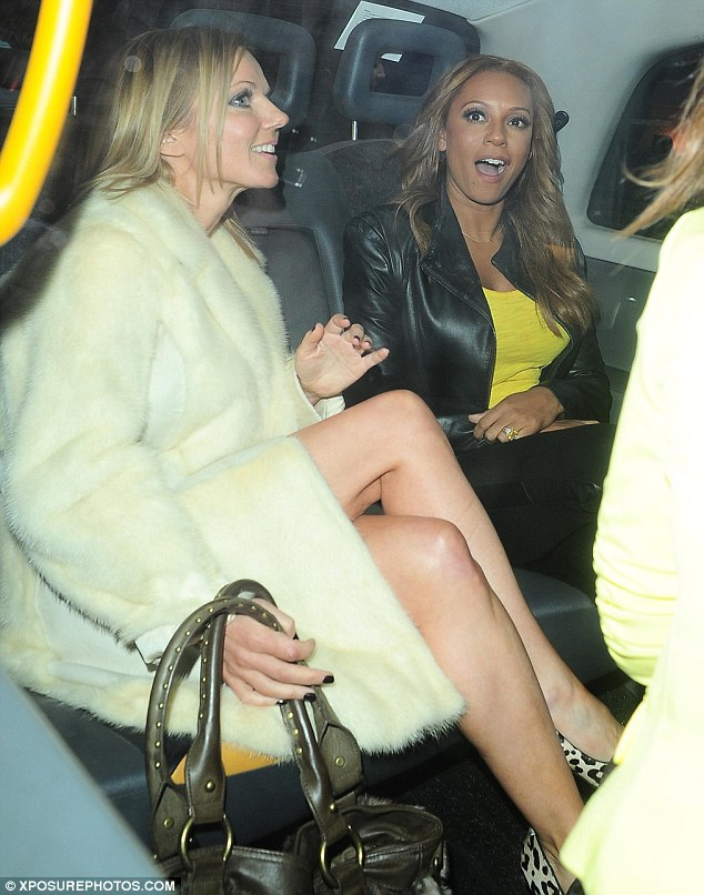 Where to? The Spice Girls jumped into a black taxi together after the launch