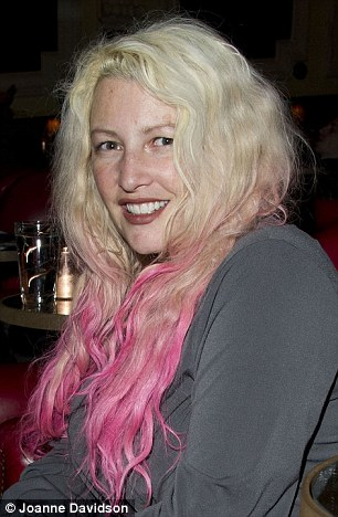 New look: Jane with her blonde and pink dip-dye (left) and with her former red hair last year (right)