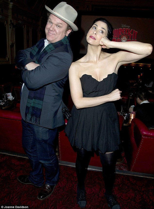 Goofing around: John and Sarah play for the cameras