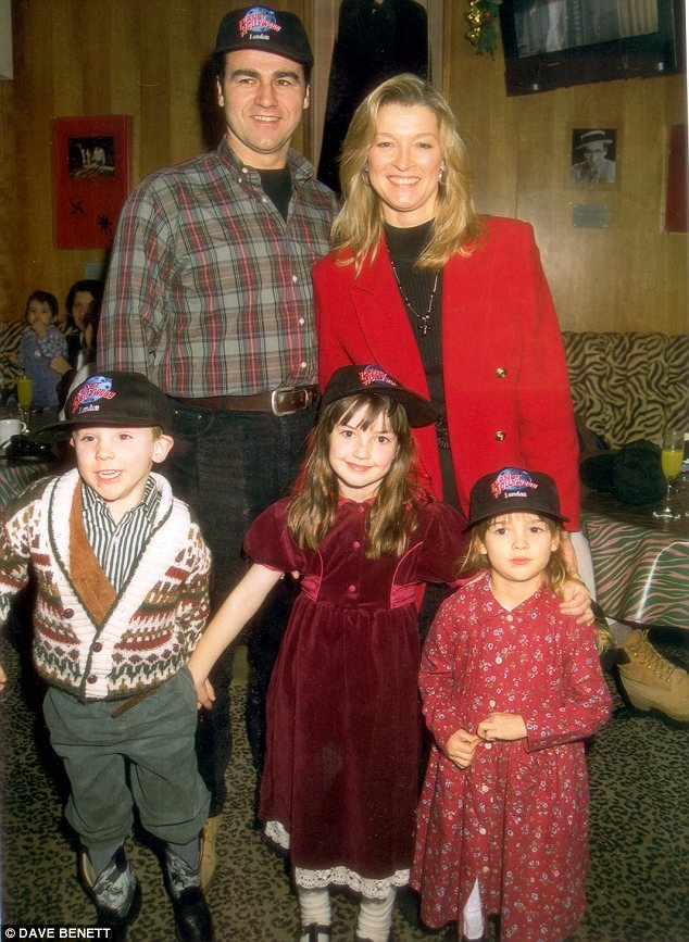 With the brood: Gillian pictures with her daughter Jessica, her son Harrison and a young female friend with her former husband in 1995