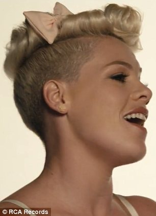 Bowtiful: In other portions of the video Pink belts the track into a microphone with a bow in her hair