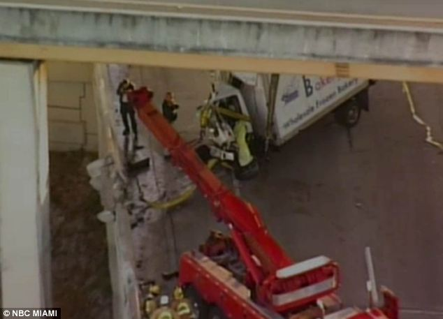 Safety: Around 7.30 a.m., workers pulled the truck back onto the bridge using lines