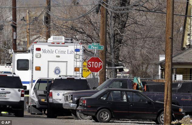 Police investigate the scene of a shootings in the Globeville neighborhood in Denver on Wednesday morning