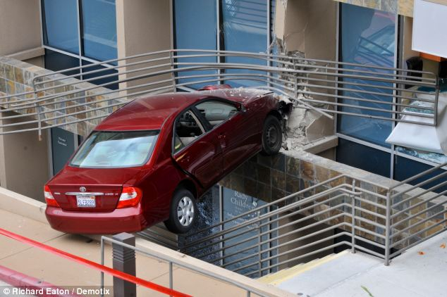 Teetering: The was left suspended over an outdoor staircase after crashing into a clinic at Rady Children's Hospital