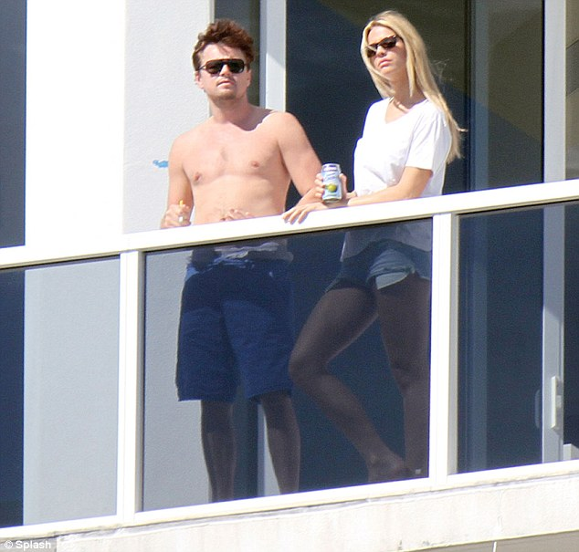 Keeping good company: The newly-single Hollywood actor soaked up the sun with his attractive companion on Sunday