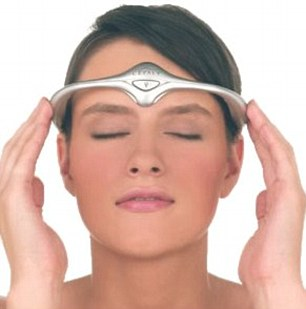 The device is hooked over the ears and worn across the forehead like futuristic sunglasses