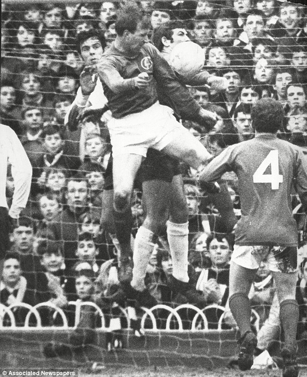 Daring: Jack Charlton jumps up with Tottenham defender Mike England and goalkeeper Pat Jennings in a 1969 league match