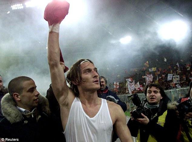 Icon: Roma's Francesco Totti celebrates a victory over bitter rivals Lazio with his adoring public