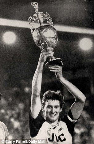 Tony Adams, the Arsenal captain, lifts the old First Division championship in 1989