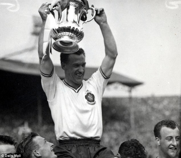 Champion: Bolton's Nat Lofthouse lifts the FA Cup after beating Manchester United 2-0 in 1958