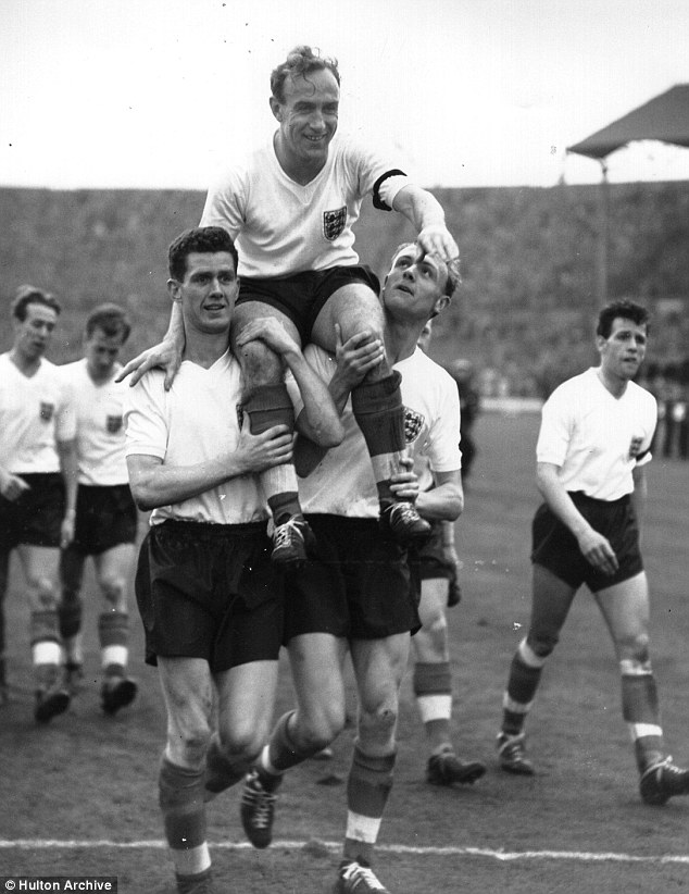Centurion: Billy Wright is carried shoulder high from the Wembley pitch after winning his 100th cap in the Home International with Scotland in 1959
