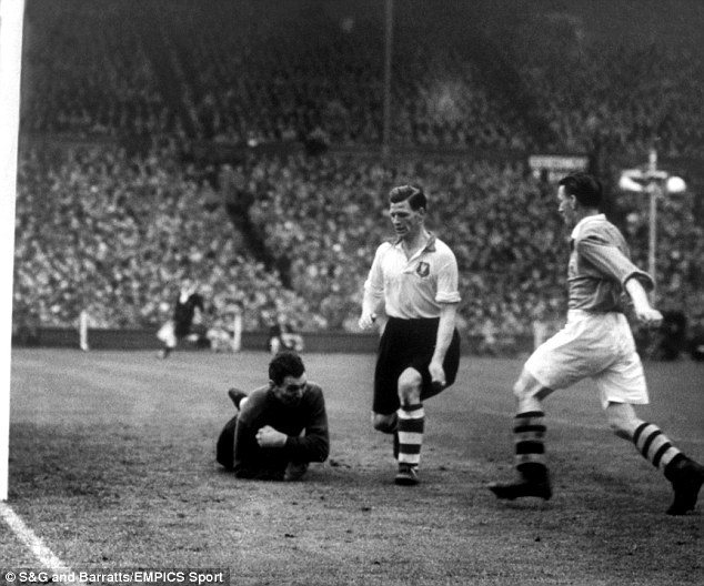 Top defender: Eddie Spicer (centre) keeps guard as his goalkeeper Cyril Swallow drops on the loose ball in the 1950 FA Cup final with Arsenal