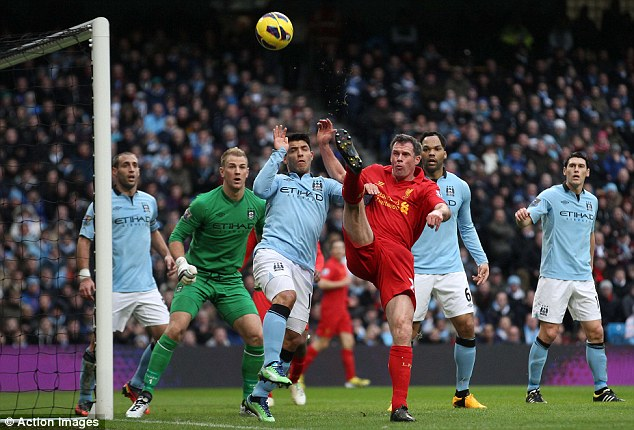 Taking them all on: Carragher attempts to get the better of half the Manchester City team during last week's 2-2 draw