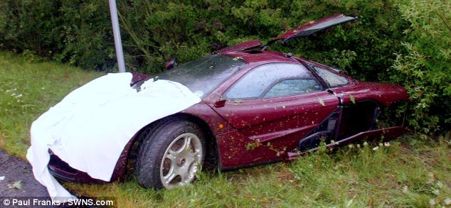 The supercar, pictured after its August 2011 crash, is one of only 64 roadgoing McLaren F1s built by the British company