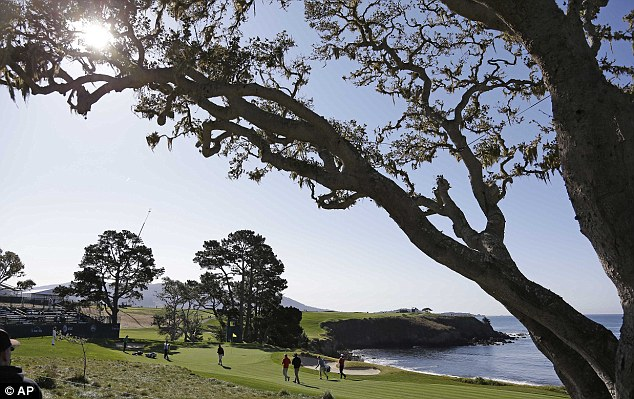 Nice work if you can get it: Padraig Harrington and his group make their way to the fifth green at Pebble Beach